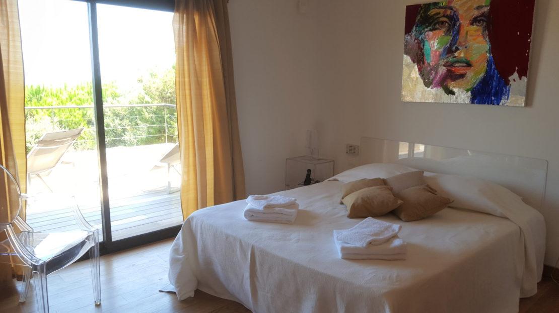 chambre location villa de luxe piscine vue panoramique porto vecchio sud corse palombaggia